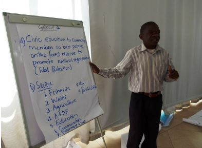 A participant making a presentation during plenary in one of the training sessions