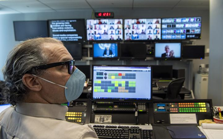 A view from the UNTV studio as members of the Security Council hold an open video conference in connection with the situation in the Middle East (Yemen). In front is John Montenero, Senior Broadcast and Conference Operator at the Office of Information and Communications Technology (OICT).