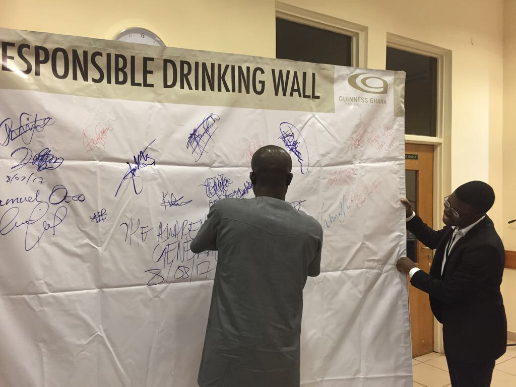 "Workshop participants making the pledge ""I Never Drink and Drive"""