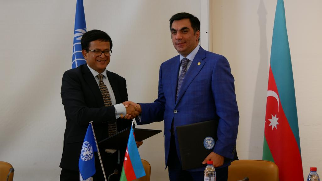 (from left) Mr. Nikhil Seth, United Nations Assistant Secretary-General and Executive Director of UNITAR and Mr. Elmar Gasimov, Rector, Baku Higher Oil School shaking hands after signing.